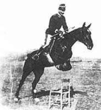 """Caprilli jumping horse over a chair"""